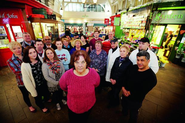 Joy Hetherington of Oxford Aromatics with Oxford Covered Market traders, who are angry at the city council, which they say is failing to honour an agreement about rent arbitration. Picture: OX66091  Damian Halliwe