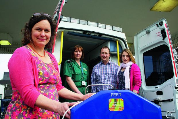 The Oxford Times: From left: Dr Charlotte Bennett, neonatal consultant at the John Radcliffe Hospital, St John Ambulance neonatal transport driver Adele Hambidge, and  James and Claire Down, parents of two boys who were born premature and died