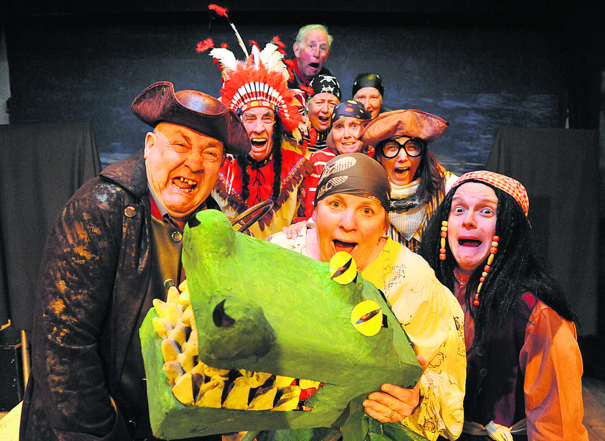 CROCS AWAY: Front, from left, Mick Major, Nathalie Soanes, Roy Peach; back, from left, Brian Mills, Nick Meyjes, Kate Mills, Maureen Brooks, Carole West and Karen Collins