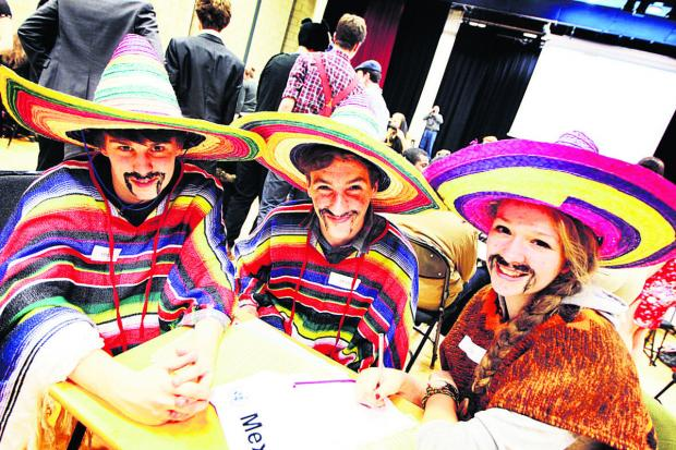 DRESSED UP: From left, Sam Foster, Ollie Bingham and Emma Kowal-Cooper represent Mexico