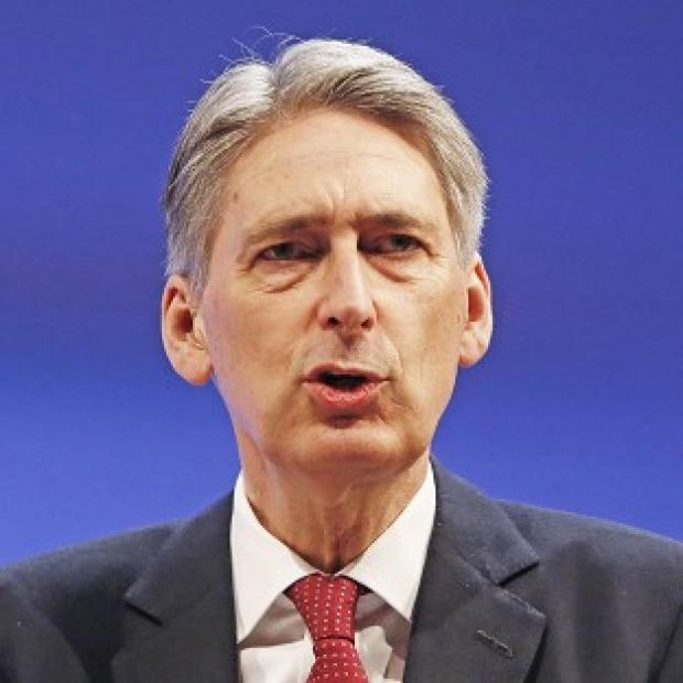 "The Oxford Times: Defence Secretary Philip Hammond has condemned ""sniping"" at Britain's military strength"