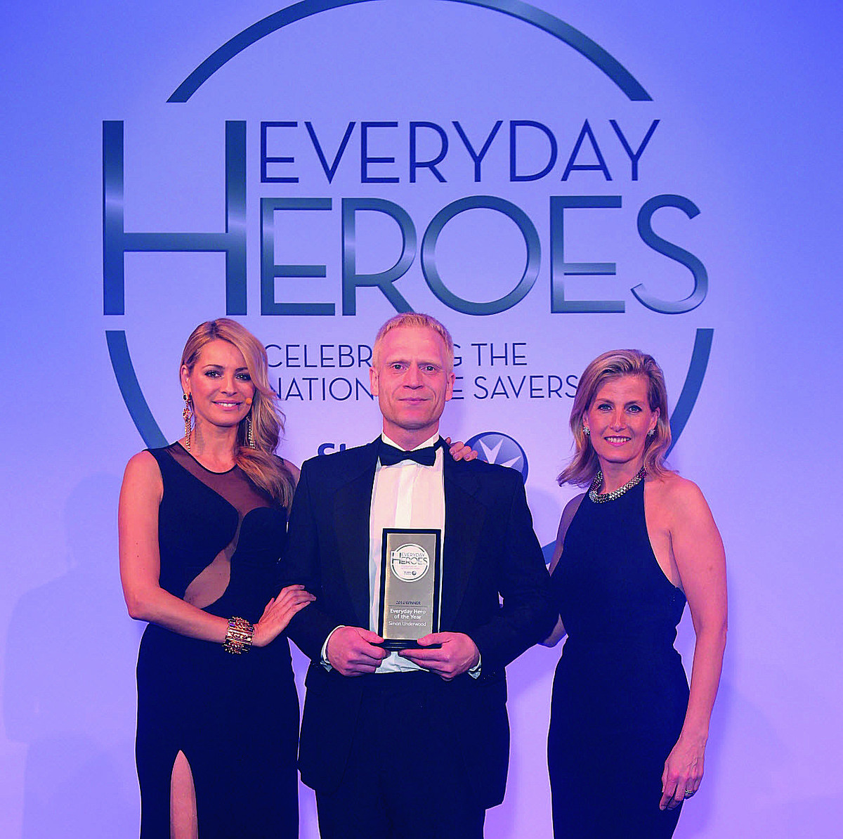 Everyday Hero of the Year winner Simon Underwood with the Countess of Wessex and TV star Tess Daly