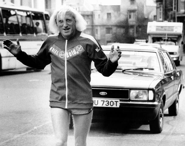 Jimmy Savile, pictured on a charity run in Oxford in 1979