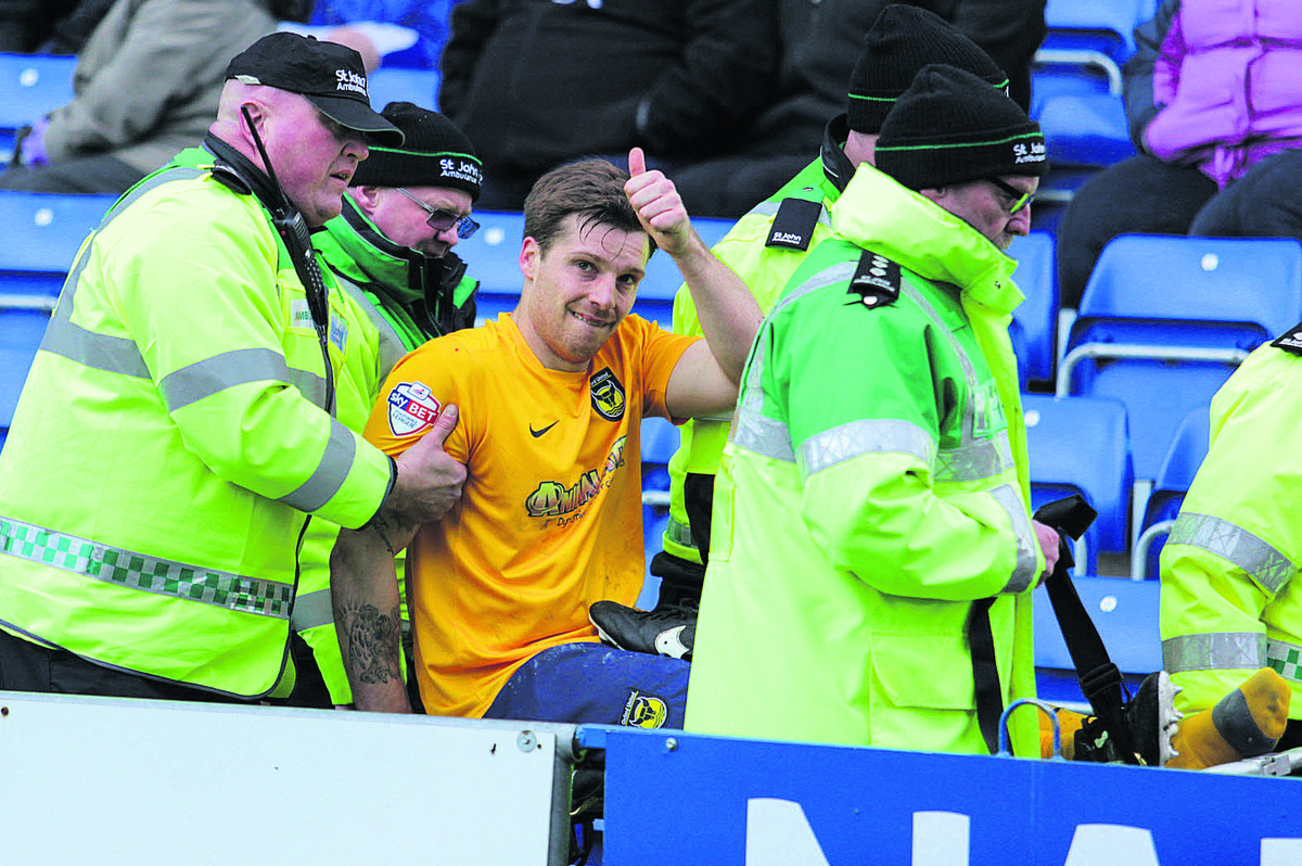 Johnny Mullins is carried off at Chesterfield after injuring his foot