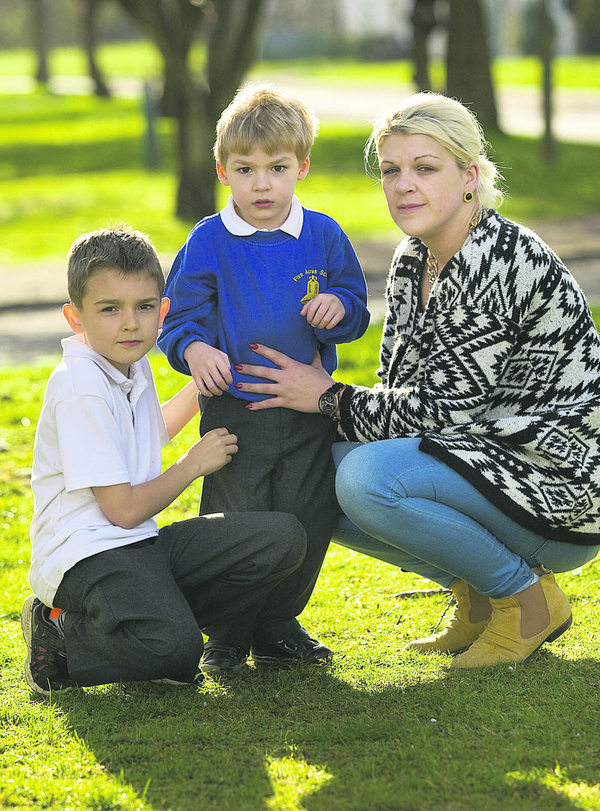 Oliver McConnell with mum Danielle and brother Josh, left. He has now been given a replacement walking frame