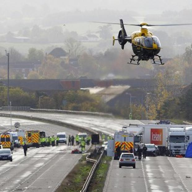 The Oxford Times: Emergency services work at the scene on the M5 motorway close to Taunton following the pile-up