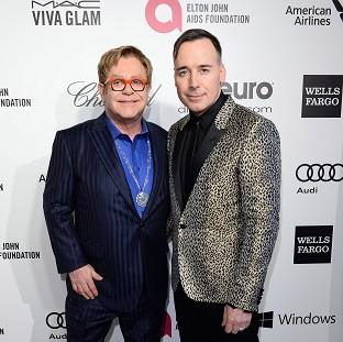 "The Oxford Times: Sir Elton John and David Furnish are planning a ""low-key"" wedding after a change in the law"