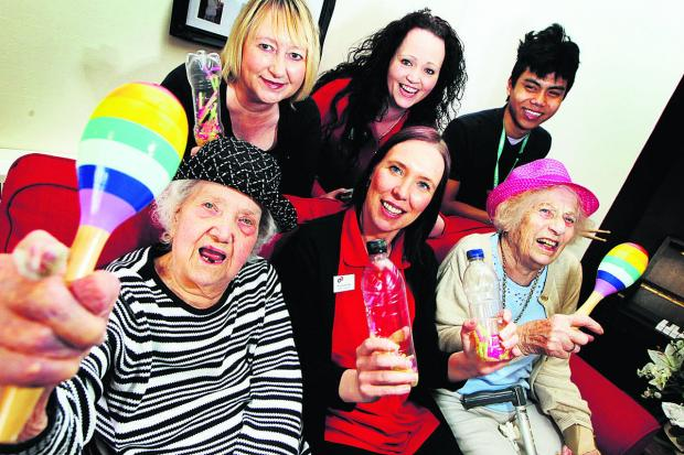 The Oxford Times: Front, from left, Longlands care home resident Ellen Thomas, 92, activities coordinator Angela Lindsay and resident Joyce Nagle, also 92; back, from left, volunteer Suzanne Mun, Sharon Wheeler, activity manager, and Josh Capati, work experience