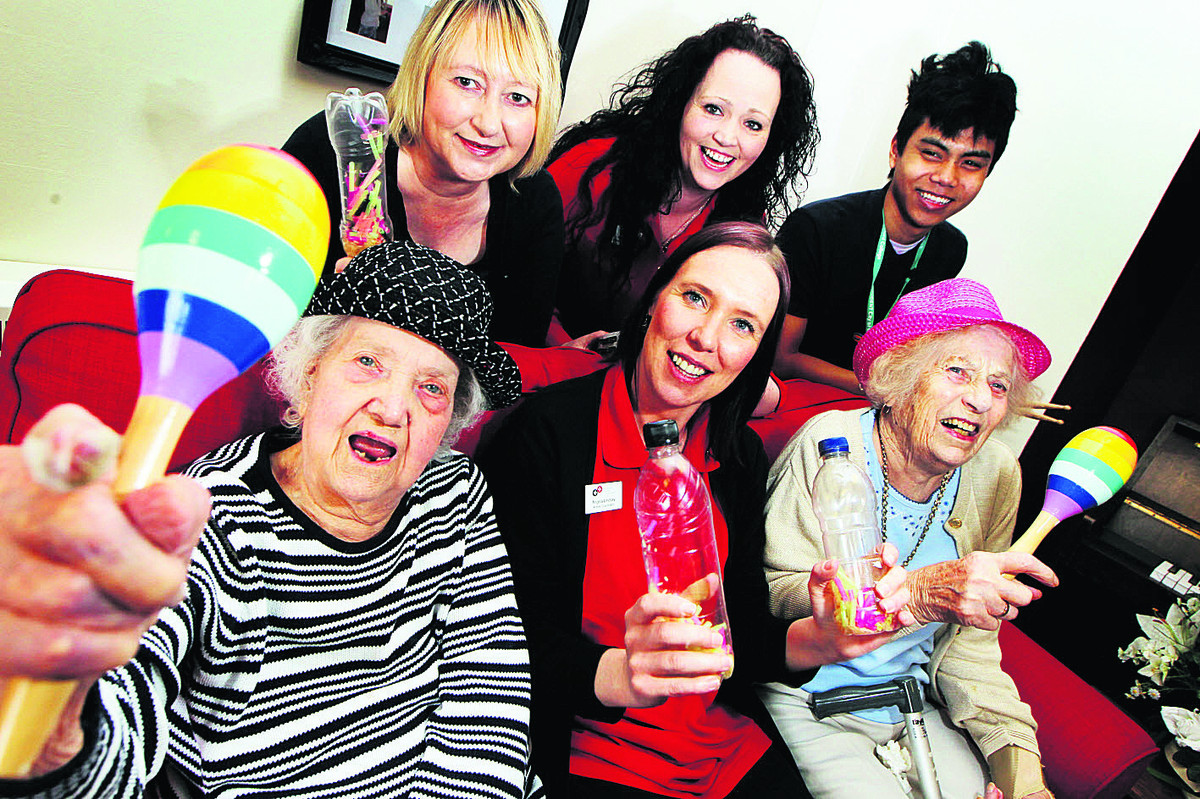 Front, from left, Longlands care home resident Ellen Thomas, 92, activities coordinator Angela Lindsay and resident Joyce Nagle, also 92; back, from left, volunteer Suzanne Mun, Sharon Wheeler, activity manager, and Josh Capati, work experience