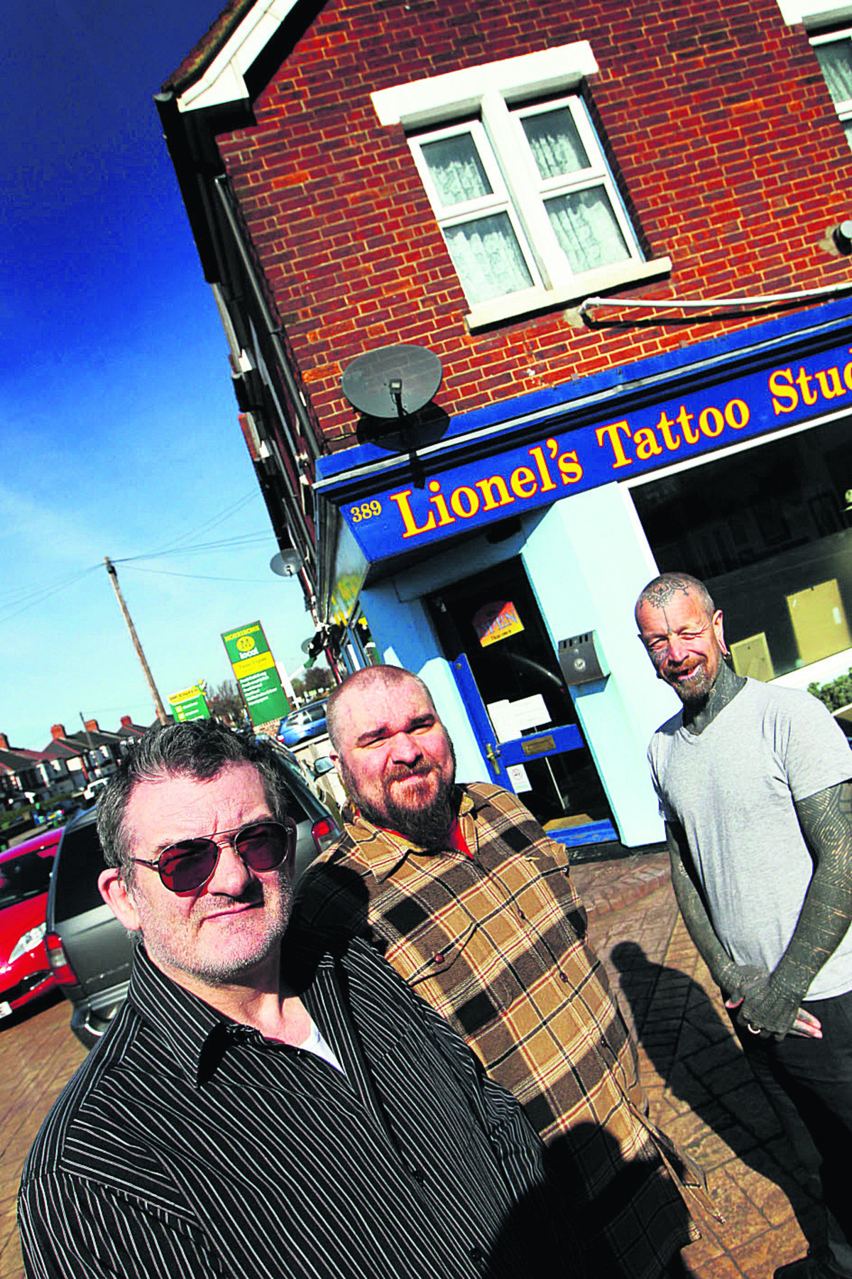 From left, Lionel Titchener, Barny Titchener and Curly Moore at Lionel's Tattoo Studio. Picture: OX66161 Ed Nix