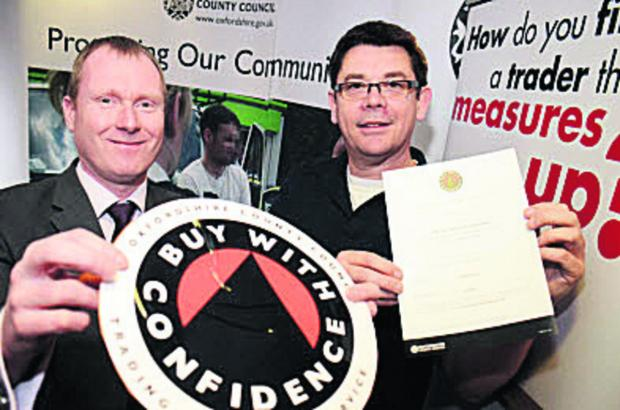The Oxford Times: Trading standards team manager Richard Webb, left, with Mark Eagle, of Eagle Plastering