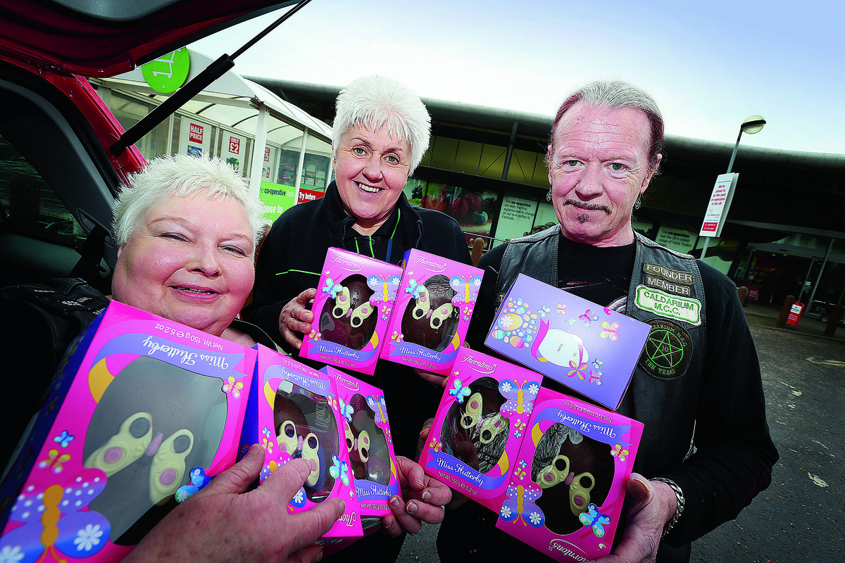 CHOC FULL: Bikers Christine, left, and George Earl of the Caldarium MCC collect Easter eggs donated by the Co-op for their May Easter egg run. Helping them load the eggs is Rita Wighton from the Co-op, in Carterton