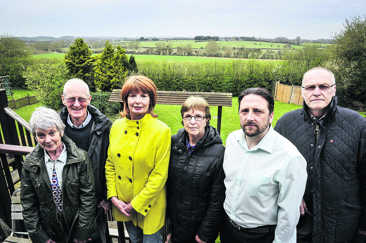 Residents, left to right, Anne and David Wilson, Jacki Dickenson, Trudi Lee, Cllr Andrew Coles and Colin Dickenson say plans to build 270 homes in Windrush Valley will spoil some of the best views in Witney