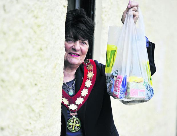 The Oxford Times: HELP: Carterton mayor Lynn Little with the first public donation of food to the food bank