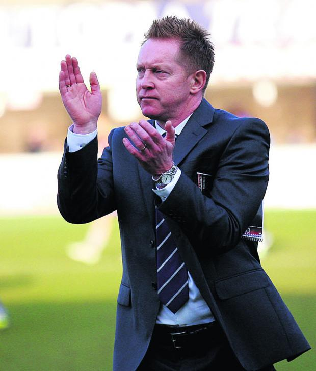 The Oxford Times: Gary Waddock applauds the United fans who made the trip to Dagenham & Redbridge last Saturday	 Picture: Dan Westwell