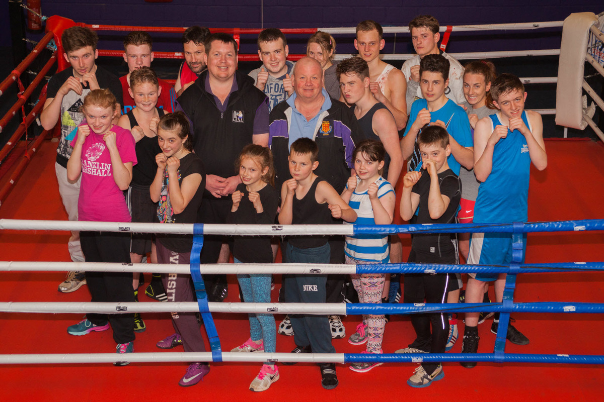 Mel Corrigan (57, centre right) and his son Lee Corrigan (centre, left, 32) with younger members of the boxing club he started 20 years ago