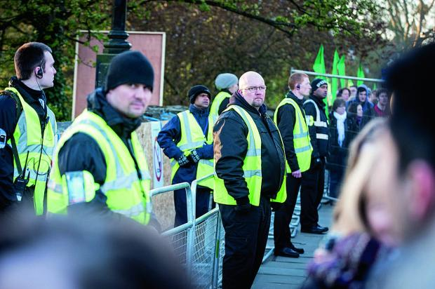 The Oxford Times: Security guards keep an eye out for potential jumpers from Magdalen Bridge at last year's celebrations