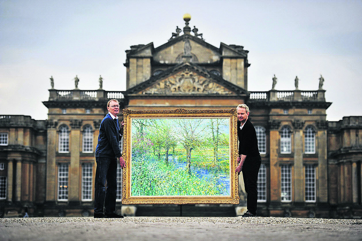 David Glaisyer, left, and son Caradoc with a Charles Neal painting at the palace              Picture: OX66336 Mark Hemsworth
