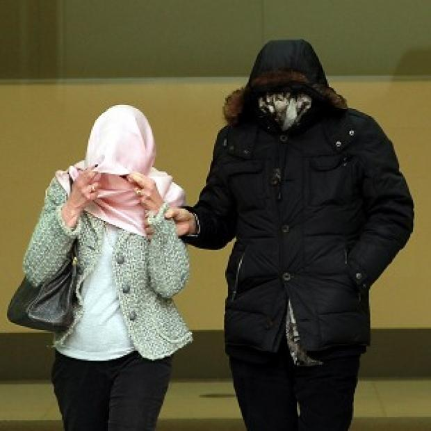 The Oxford Times: Mafia fugitive Domenico Rancadore, pictured with his wife Anne covering their faces at a previous court hearing, has been remanded in custody.