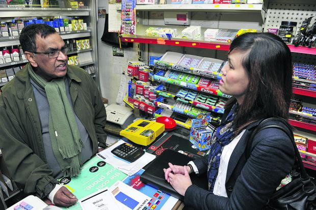 The Oxford Times: Shopkeeper Vijaya Karunaratne talks to crime prevention and reduction adviser Julie Young. Pictures: OX66198 Mark Hemsworth