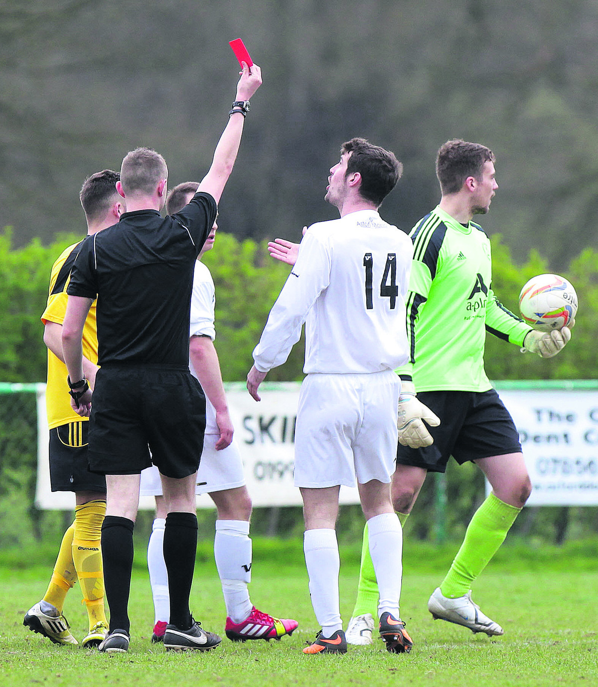 North Leigh goalkeeper Adam McHugh receives his marching order