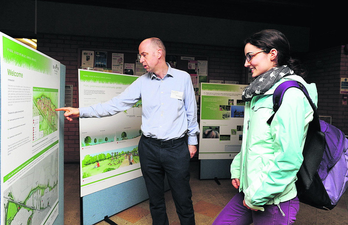 Planning consultant Paul Comerford talks to Barton resident Beth Hougham about the proposals
