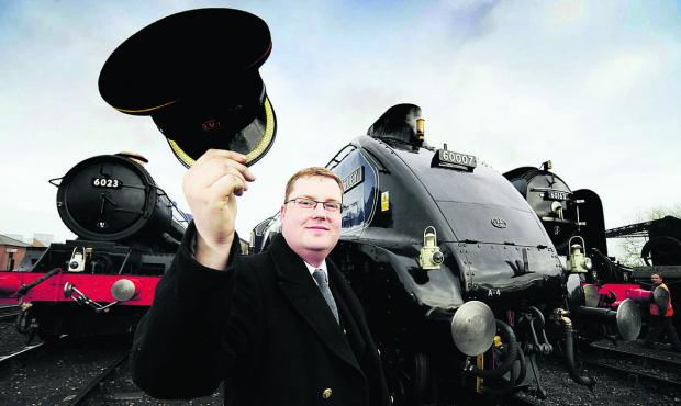 The Oxford Times: Volunteer Guard, Matt Baker, 28, with locos, from left, King Edward II, Sir Nigel Gresley and Tornado in full steam