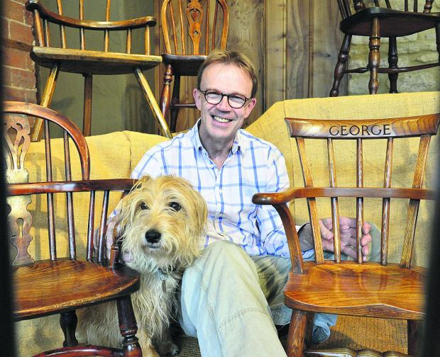 Chris Baylis and his dog Scrumpie with the chair, right