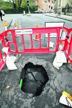 Walton Street shut in both directions because of hole in the road