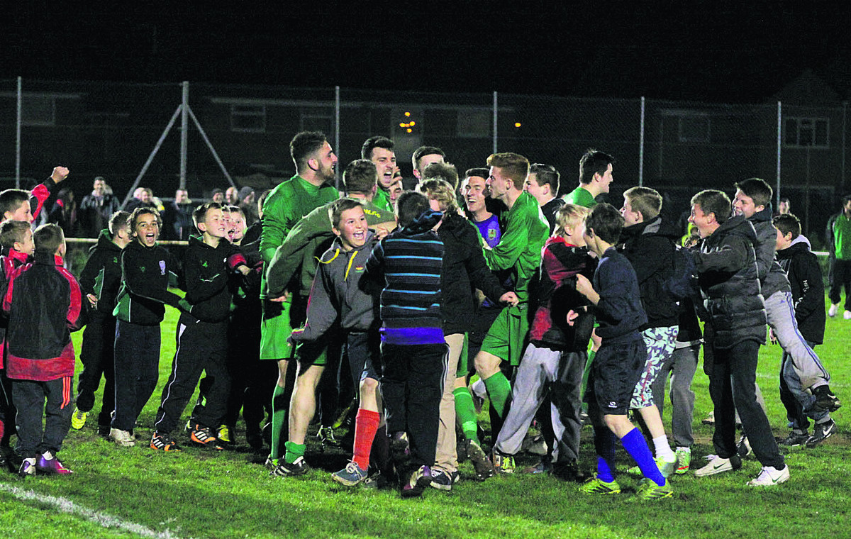 Kidlington's players are mobbed by delighted supporters after beating Oxford United  Pictures: Darrell Fisher