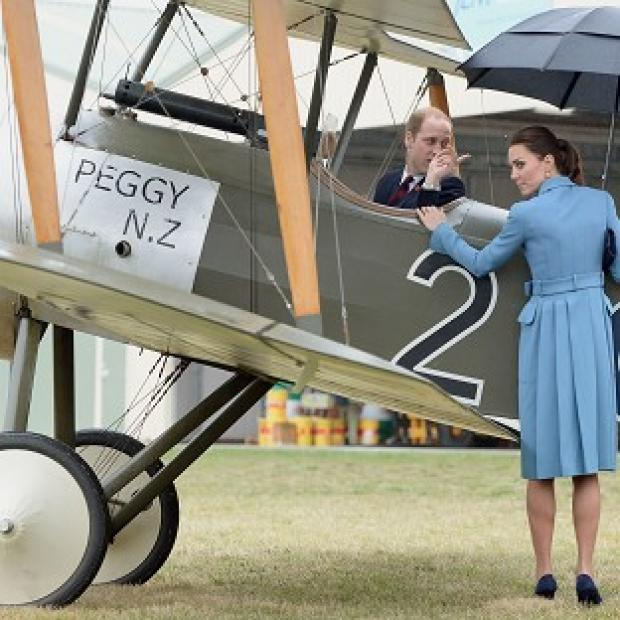 The Oxford Times: The Duchess of Cambridge looks on as the Duke of Cambridge climbs into the cockpit of a Sopwith Pup as they visit the Omaka Aviation Heritage Centre in Blenheim, during their official tour to New Zealand