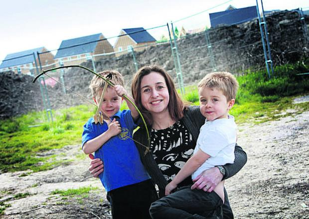 Karen Waggott, with twin boys, Jamie, left, and Luke, six, who launched the petition for an archaeological trail on the Great Western Park estate