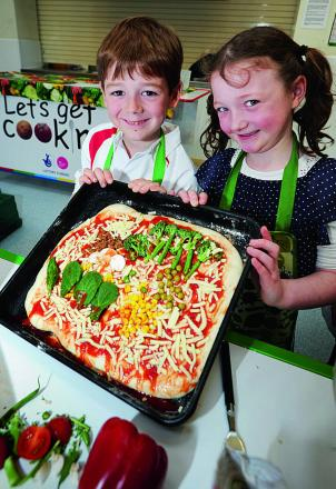 Showing off a healthy pizza the youngsters made are Alfie Simmonds, six, and Catherine Monelle, seven    Pictures: OX66376 Jon Lewis