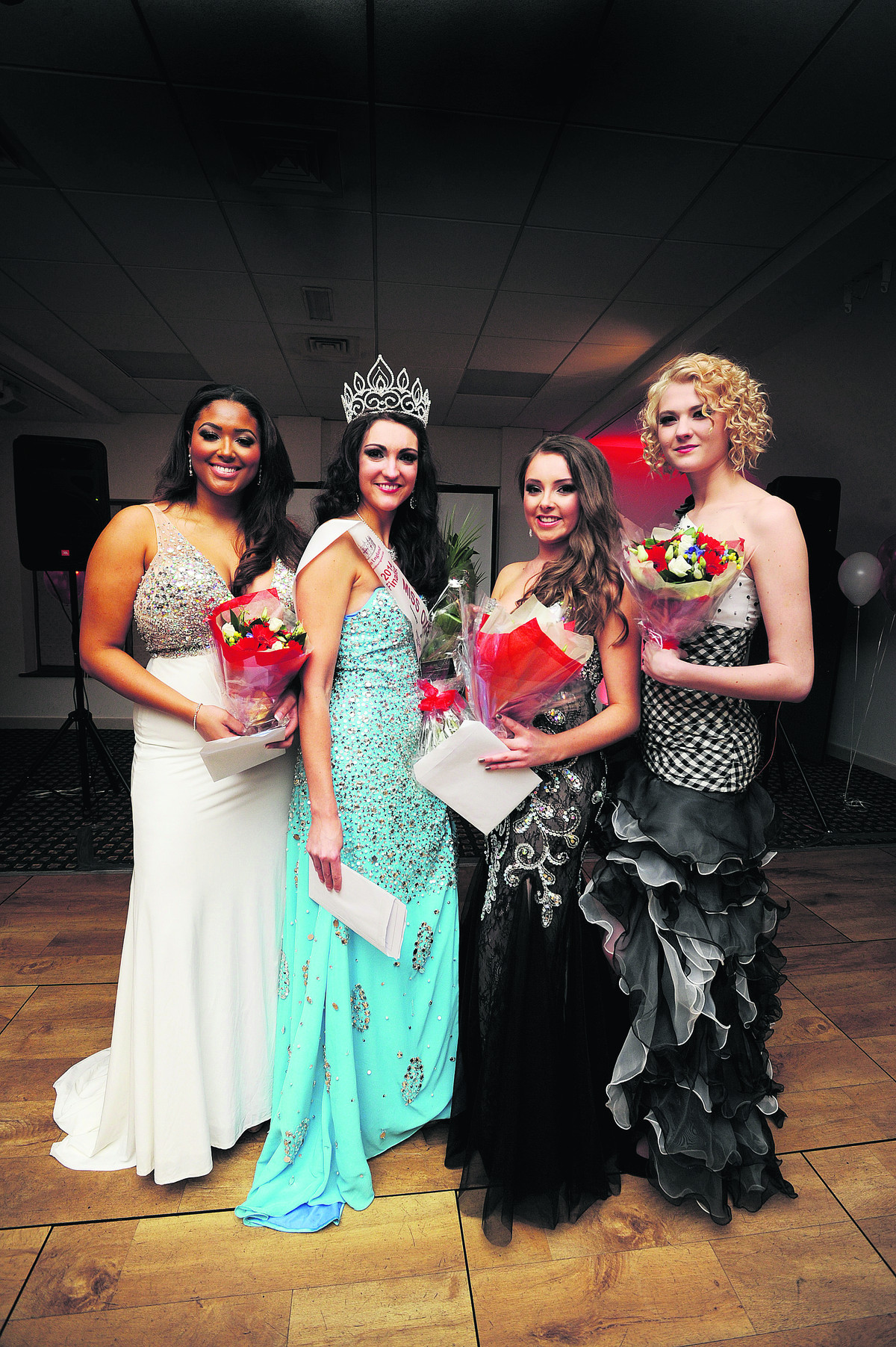 On parade, from left, Shirin Olivia, who won the popularity award, Amelia Watt, who won the charity award and the title, and runners-up Hannah Everett and Lucy Treadwell