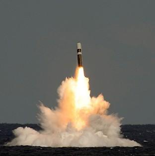 An unarmed Trident ballistic missile fired from HMS Vigilant during a test launch