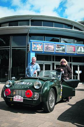 John and Heather Dresser with their green Triumph TR3a