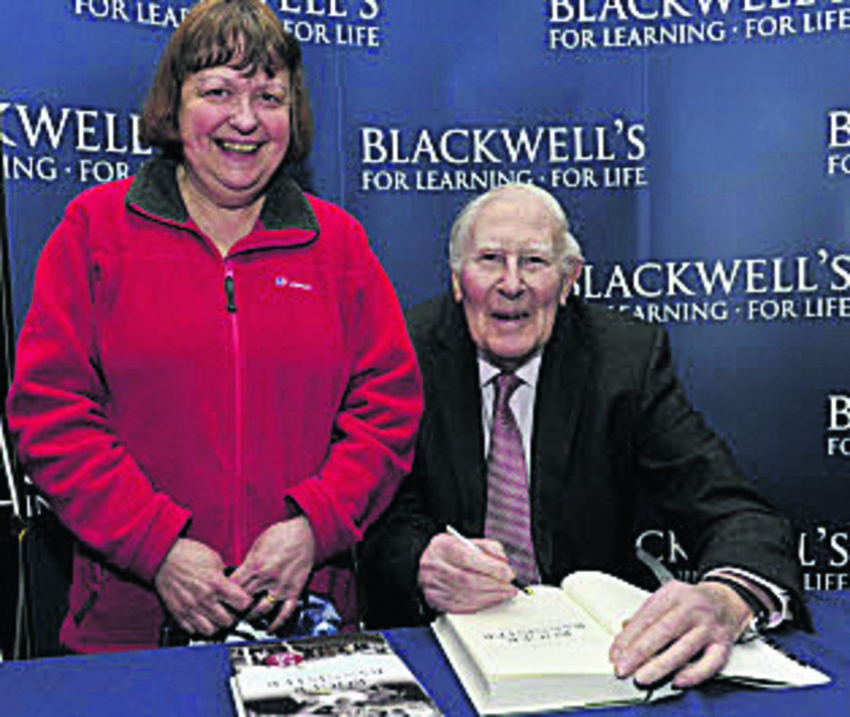 Elaine Davenport gets her copy signed by Sir Roger . Inset, fans queued for hours  Pictures: OX66519 Mark Hemsworth