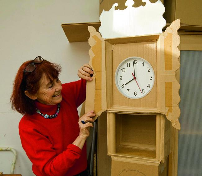 Nicola Russell with her cardboard grandfather clock