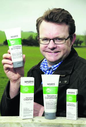 Tim Davies with some of his skincare products. Picture: OX66297 David Fleming