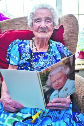Margaret Rose reads her birthday card bearing congratulations and best wishes from the Queen. Picture: OX66680 Cliff Hide