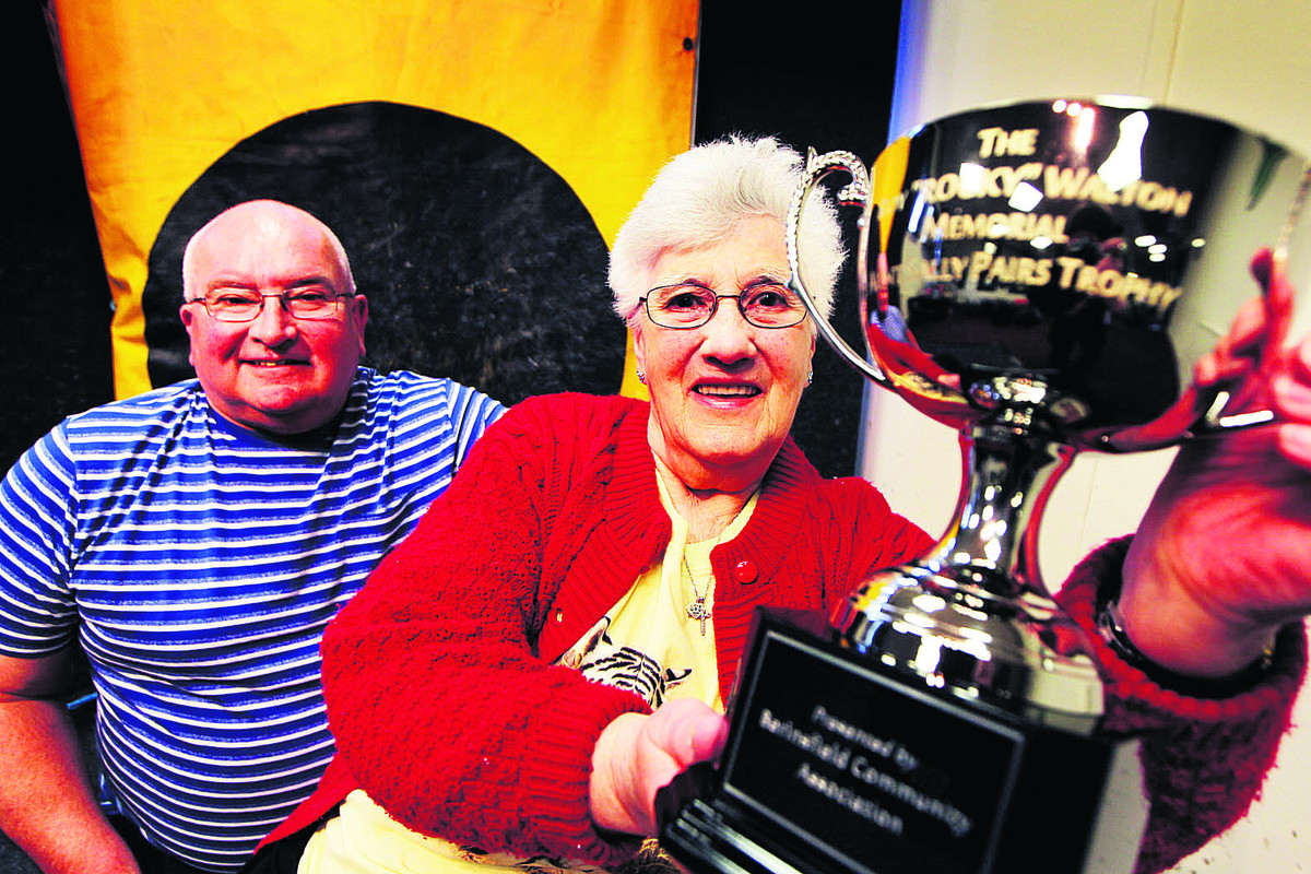 A former Oxford Mail newspaper delivery man, the late Roy Walton, is getting an Aunt Sally trophy dedicated to him in his home town of Berinsfield. Pictured above is club organiser Brian Spurrett with Mr Walton's widow, Sylvia     Picture: OX6660 Ed Nix