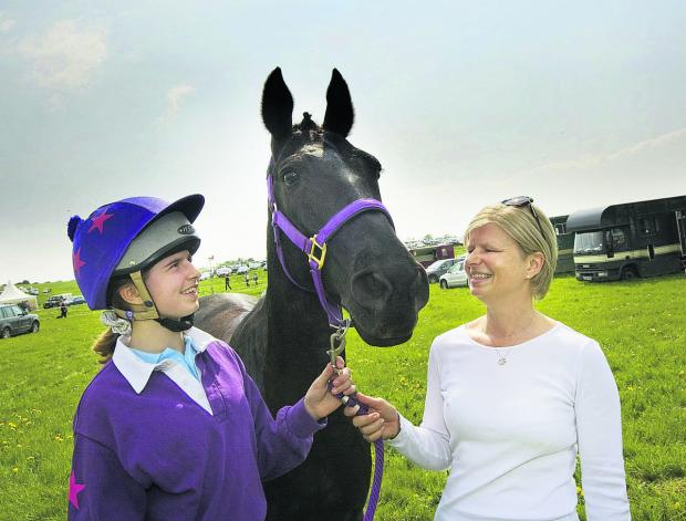 Sophie Gordon with Midnight Spartacus and mum Jenny