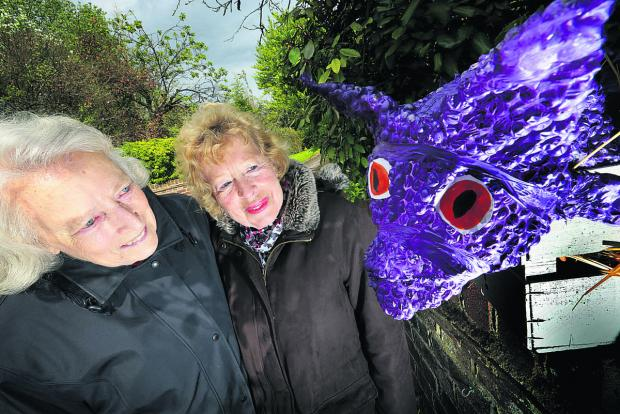 West Hagbourne Village Association chairwoman Valerie Walton, right, with her predecessor, Betty Kendrick and a baby dragon