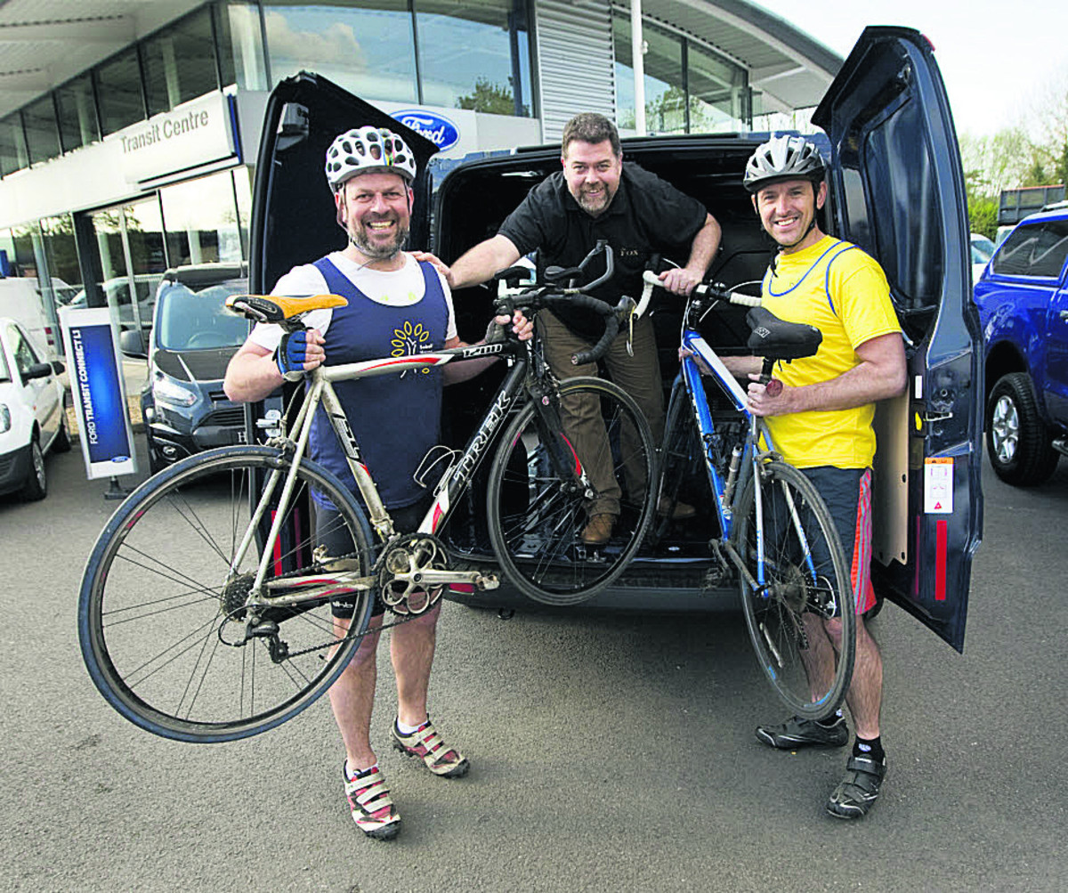 Cyclists Mark Crick and Neil Barson with pub landlor