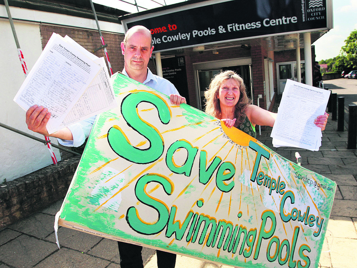 Nigel Gibson and Jane Alexander with a poster and sheets from their petition outside Temple Cowley Pools in 2010
