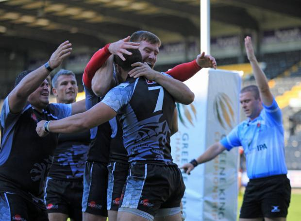 The Oxford Times: Carl Kirwan (7) is congratulated by his London Welsh teammates after scoring a try in their 46-19 victory at Nottingham in September. Can he repeat that feat today?