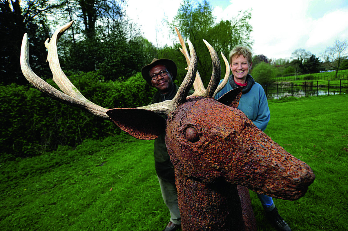 Event organiser Lendon Scantlebury with wildlife and equine sculptor Miranda Michaels and her work Fallow Buck