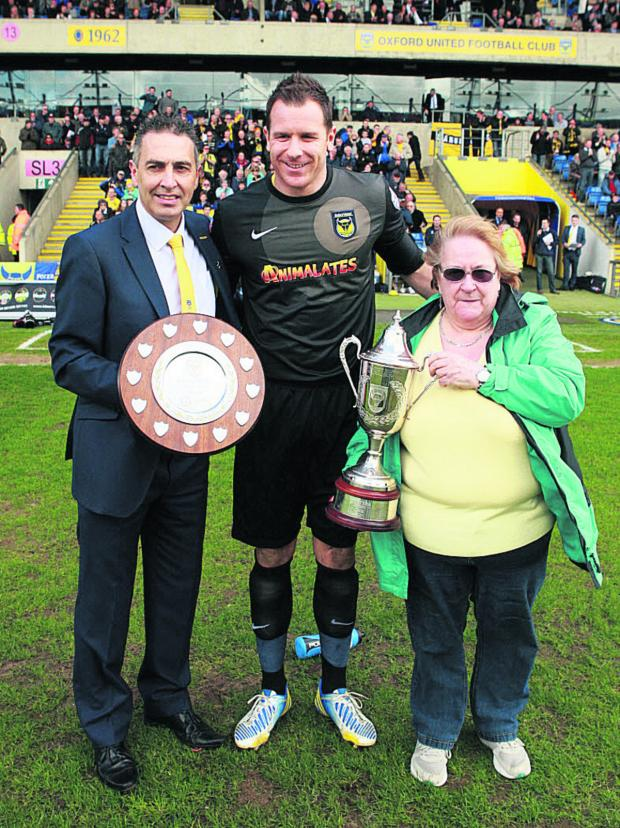 The Oxford Times: yan Clarke collects his players' player and supporter's player of the year awards from Peter Rhoades-Brown and Gill Dix
