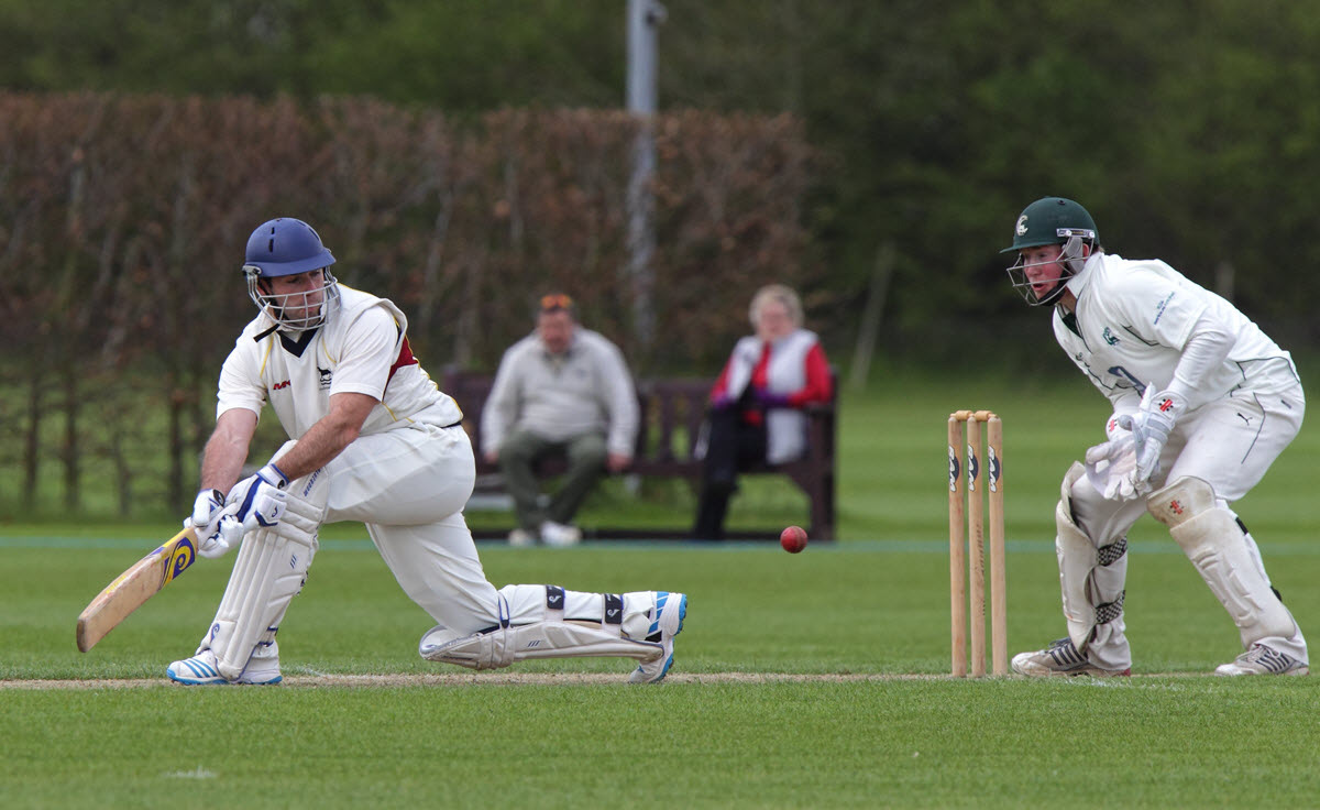 Oxfordshire batsman Chris Watling gets some legside runs past Berkshire wicket-keeper Stewart Davison during his side's victory at Bicester & North Oxford