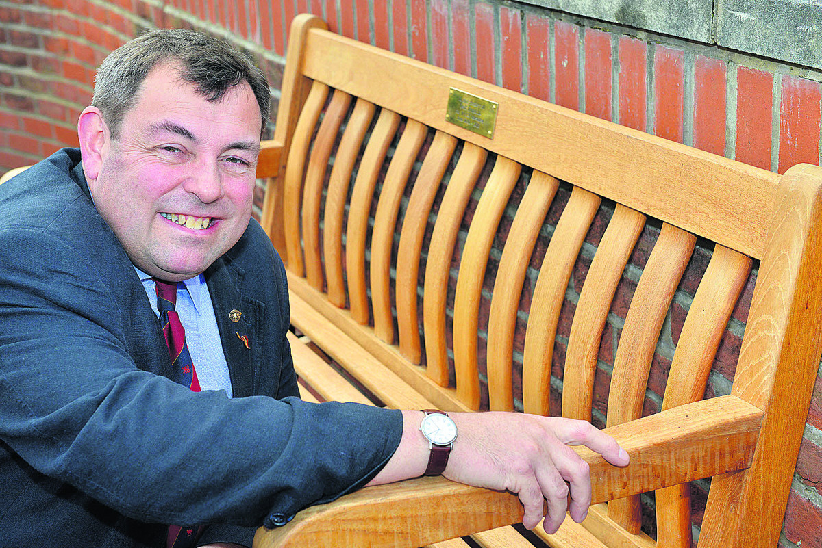 Colin Cook with the bench dedicated to Geoff Franklin
